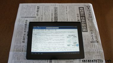 Newspaper_and_tablet
